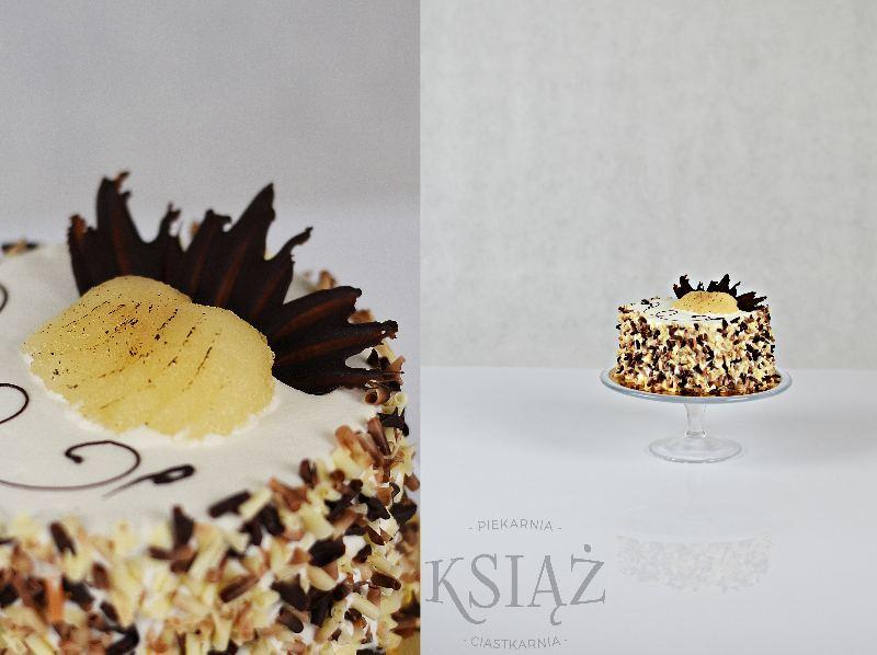 Tort czekoladowo-gruszkowy I T007 - jasny biszkopt, przełożony śmietaną czekoladową i gruszkową