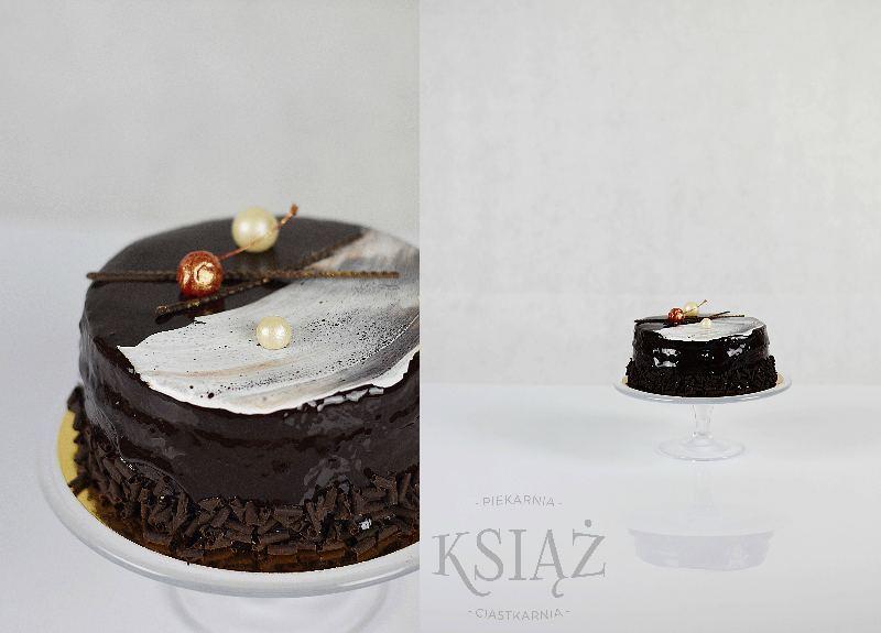 Tort węgierski T023 - ciemny biszkopt, przełożony śmietaną z wiśniami, z dodatkiem spirytusu