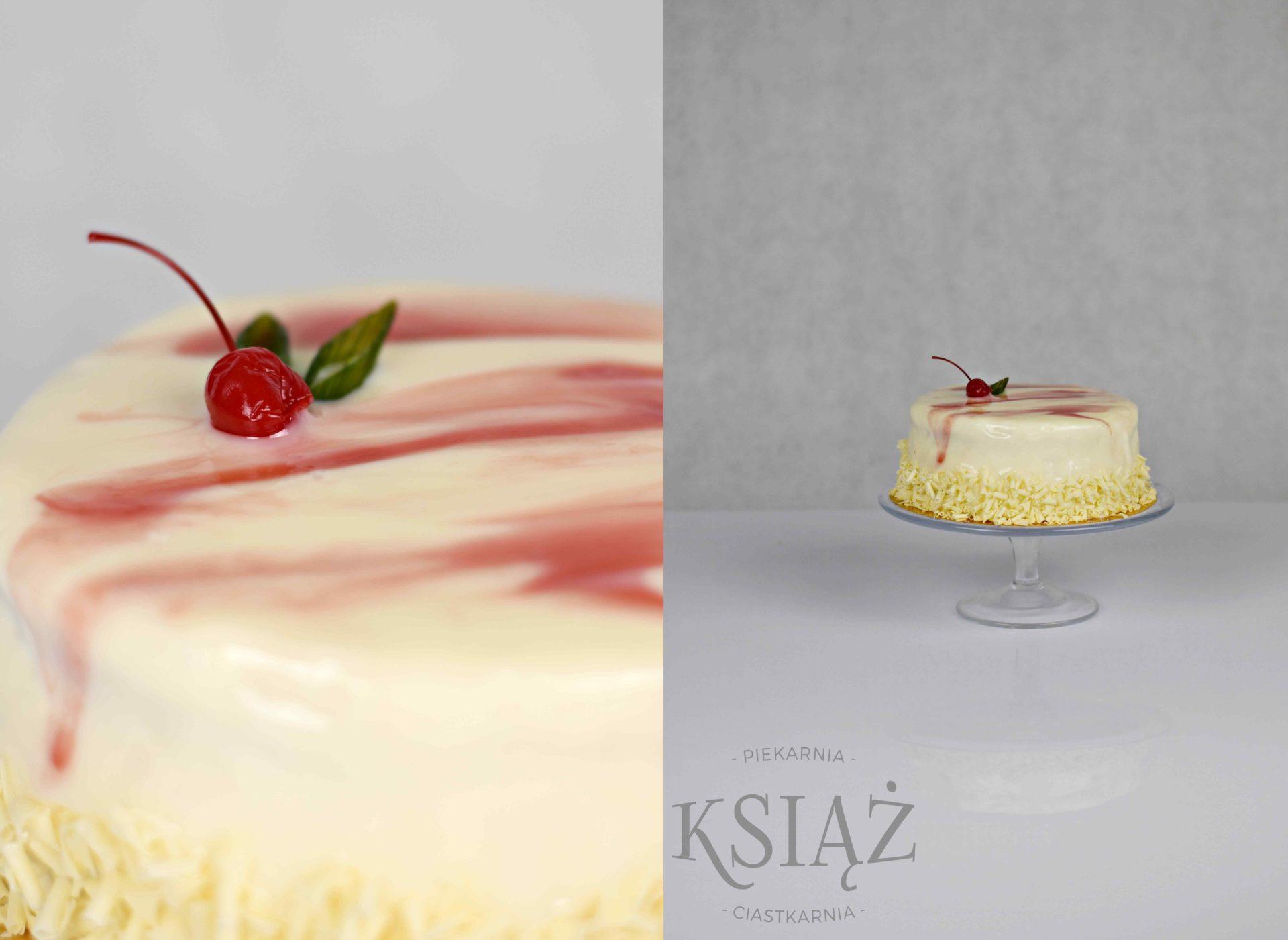 Tort jogurtowo-wiśniowy T009 - jasny biszkopt jogurtowy, przełożony śmietana jogurtową z dodatkiem wiśni